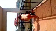 Striptease On A Balcony